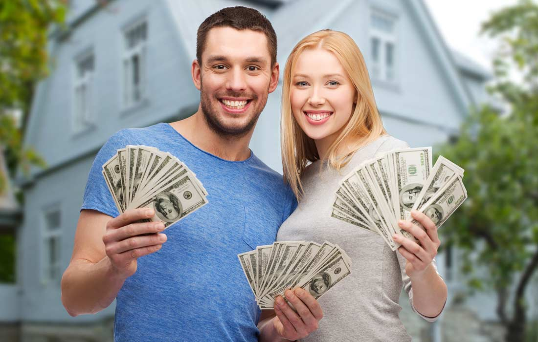 couple holding money